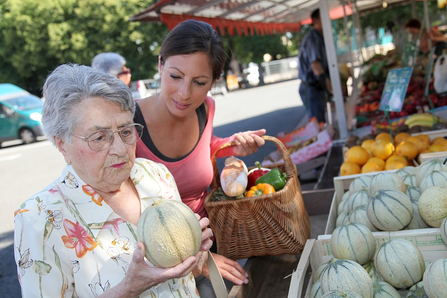 bigstock-Young-woman-helping-elderly-wo-16987553